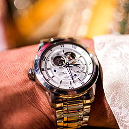 man watch close-up hand metal gold fashion zoom UGC content