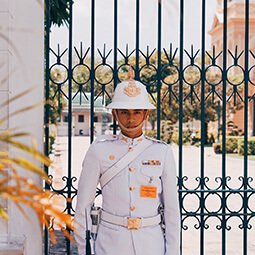 man guard asia white gold uniform gate entrance palace real UGC travel content photography